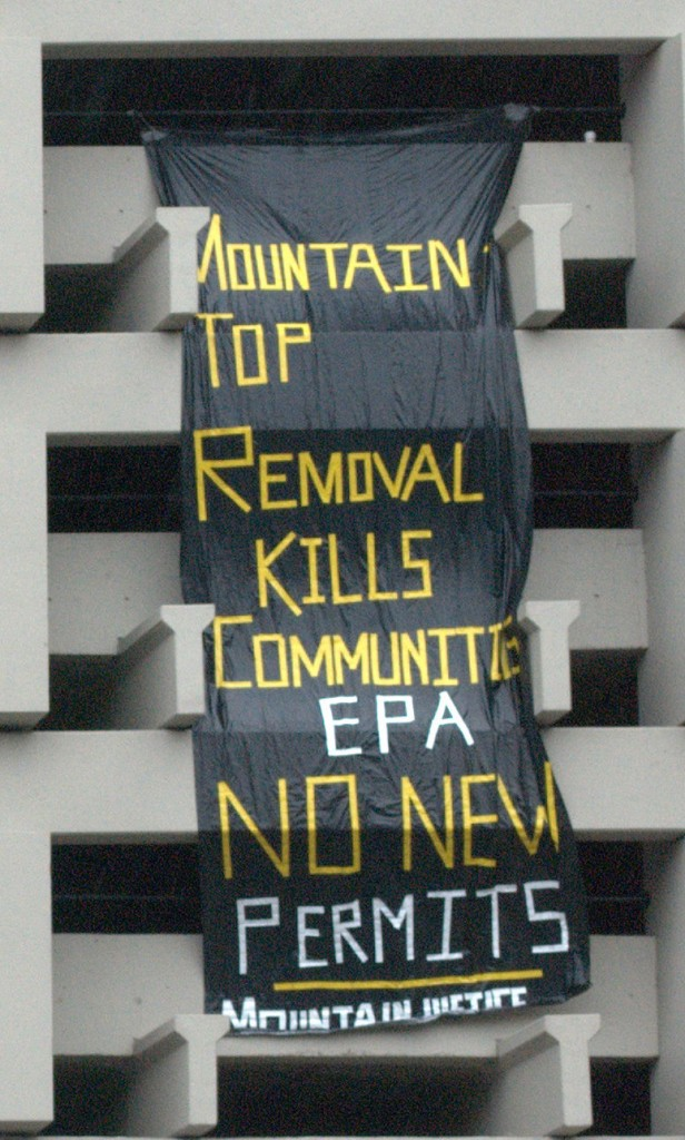 Activists with Rising Tide draped this 25-foot banner on the downtown DC offices of the Environmental Protection Agency.