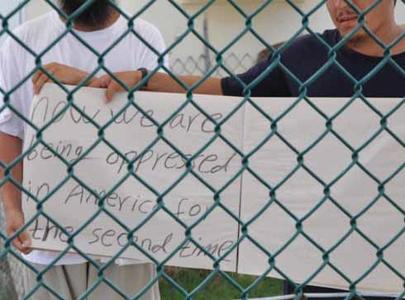 A protest sign held by two Uighur prisoners at Guantanamo.