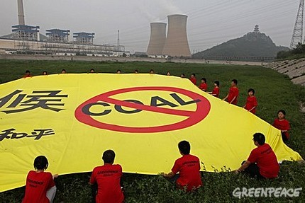 Greenpeace activists in China unfurled a banner condemning the use of coal, near one of the Beijing's largest coal-fired power plants.