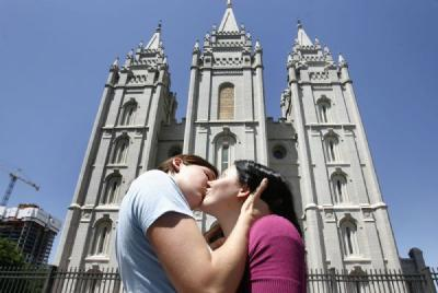 "For the second consecutive weekend, about 100 people in Salt Lake City staged a ""kiss-in"" to protest the treatment of two gay men cited for trespassing July 9 after they shared a kiss on the plaza owned by The Church of Jesus Christ of Latter-day Saints."
