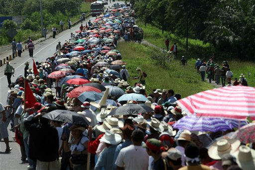 A column of about 10,000 anti-coup protesters marched into Tegucigalpa on Tuesday to demand the return of ousted President Manuel Zelaya. An additional 4,000 Zelaya supporters gathered in San Pedro Sula, the country's second largest city. (AP Photo/Rodrigo Abd)