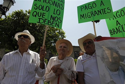 About 400 people marched outside the North American Leaders Summit in Guadalajara, Mexico on Sunday to protest the negative affects of free trade and to demand benefits for retired Mexican laborers who worked in the US.