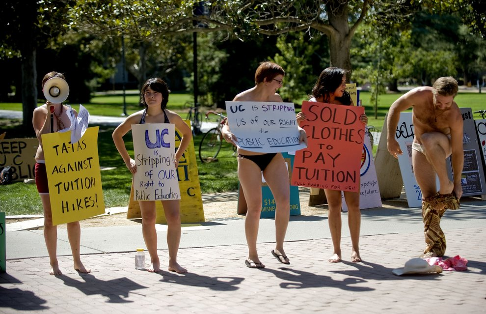 UC Davis graduate student Kurt Vaughn, right, joined other minimally clothed students as they protest a plan to raise fees. The rally's goal was to get other students to join in a walkout today, the first day of classes.
