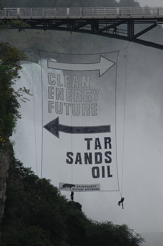 Ahead of Canadian Prime Minister Stephen Harper's first official visit to the White House, a small team of climate activists rappelled from the US observation deck at Niagara Falls and dropped this vivid 70-foot banner against tar sands.
