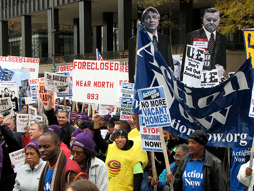"""More than 5,000 people packed the streets of downtown Chicago yesterday morning, chanting, marching and rallying outside the American Bankers Association conference on the third and final day of what was billed as the """"Showdown in Chicago."""""""