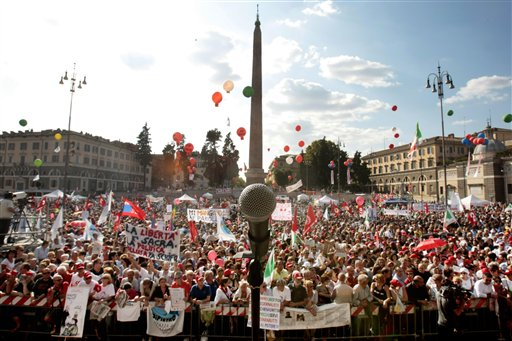 "Tens of thousands of people, including journalists and media rights activists, gathered in Rome's Piazza Del Popolo Saturday to defend press freedom, accusing Premier Silvio Berlusconi of trying to silence critical voices, but the media owner magnate, Berlusconi dismissed the accusations as a ""joke"". (AP Photo/Gregorio Borgia)"