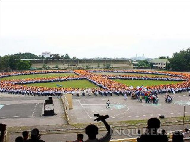 Some 10,000 high school students here formed a human peace symbol during a mammoth rally held Wednesday in support of the call for world peace and non-violence. Meanwhile,more than 2,000 students, soldiers from the Philippine military government officials and NGO workers joined the colorful World March for Peace and Nonviolence in Manila's Malate district.
