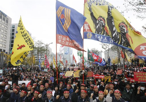 Tens of thousands of South Korean workers rallied Saturday to protest the government's plan to begin implementing contentious labor laws. (AP Photo/Ahn Young-joon)