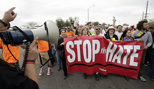 In Phoenix, more than 20,000 people marched on Saturday to protest the indiscriminate attacks and race-based raids conducted by Sheriff Joe Arpaio against residents of Maricopa County. (AP Photo/Ross D. Franklin)