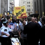 Protesters march on Wall Street on June 6, 2011. Photo by Nathan Schneider.