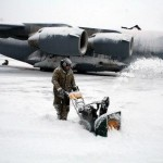 MANAS AIR BASE, Kyrgyzstan (AFPN) - Airman 1st Class Michael Lepla digs out a C-17 Globemaster III.