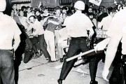 Police confront demonstrators in Chicago near the 1968 Democratic National Convention headquarters.