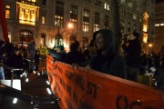 Occupiers use orange police netting as a defense against police.