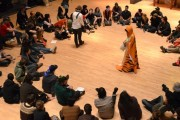 A recent Occupy Wall Street meeting being facilitated by an organizer in a tiger suit.