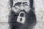 Khader Adnan stencil on a wall by Manara square, Ramallah. By Friends123, via Wikimedia Commons.