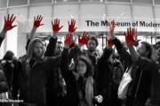 From a January 27 Occupy Wall Street action at the MoMA in support of the locked out Sotheby's workers. Photo by @NEREphotography, via Occupy with Art.