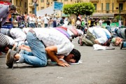 Protesters praying in Tahrir Square on May 27, 2011. By Maggie Osama, via Flickr.
