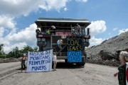 Anti-coal activists dropped banners opposing mountaintop removal at Hobet mine in West Virginia on Saturday. Photo by Mark Haller.