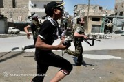Members of the Free Syrian Army running through the streets. Photo by WordswithMeaning.org, via Flickr.