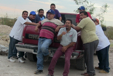 A group of the golpeadores (goons) take a break on their pickup in the mine's parking lot during the union election. Photo by Paul Bocking.