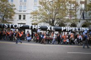 Climate activists carried a mock Keystone XL pipeline as they encircled the White House on November 6, 2011. Photo by Clayton Conn via Flickr.