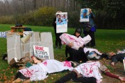 Anti-drone activists create a dramatic tableau of civilians killed during a strike at a press conference in Syracuse, NY, last year. (Flickr/Syracuse Peace Council)