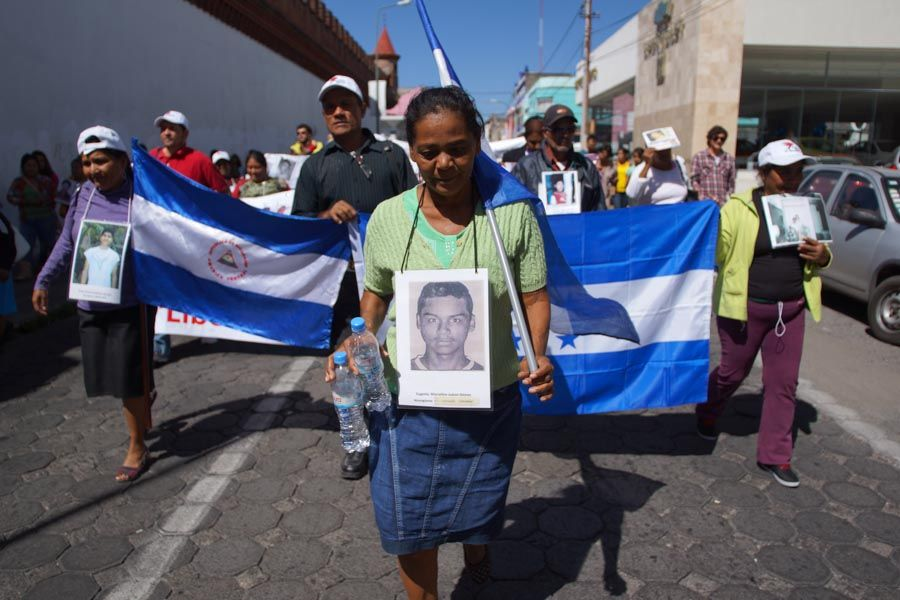 Narcicia Socorro Gómez marches with a picture of her son, Eugenio Marcelino Juarez Gómez, around her neck. (WNV/Mario Marlo)
