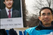 Nguyen Quoc Quan protesting in Washington, D.C. in 2010.