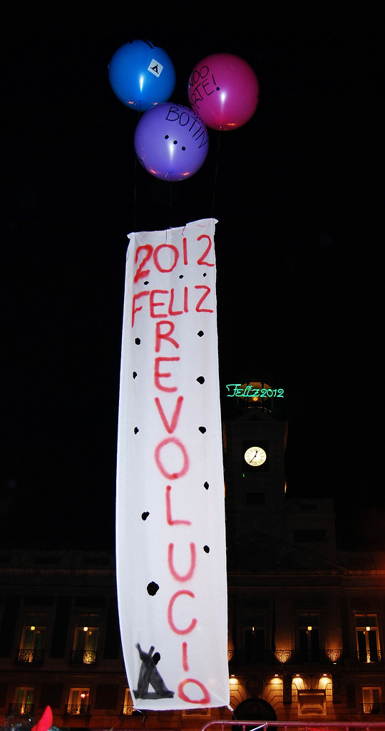 A banner made by the Indignados for last New Year's celebration. (Flickr / Popicinio)