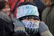 "A Russian opposition activist wears a sign that says ""I am 80. I want freedom!"" (Flickr / Sergey Kukota)"
