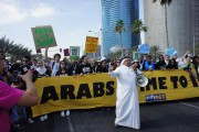 Climate activists gathered for a march on the waterfront in Doha, Qatar, on Dec. 15, calling on Arab countries to take the lead in U.N. climate change talks. (Flickr / adopt a negotiator)