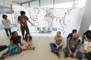 Youth organizers displayed the climate legacy map around the U.N. climate talks in Doha. (Flickr / sallie_shatz)