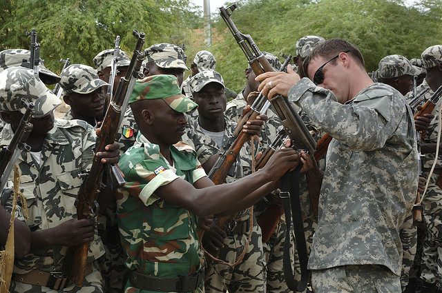 U.S. Army Soldiers from the 3rd Special Forces Group out of Fort Bragg, N.C., help inspect Malian army soldier's weapons at their garrison in Tombouctou, Mali, on Sept. 4, 2007. (Flickr/The U.S. Army)