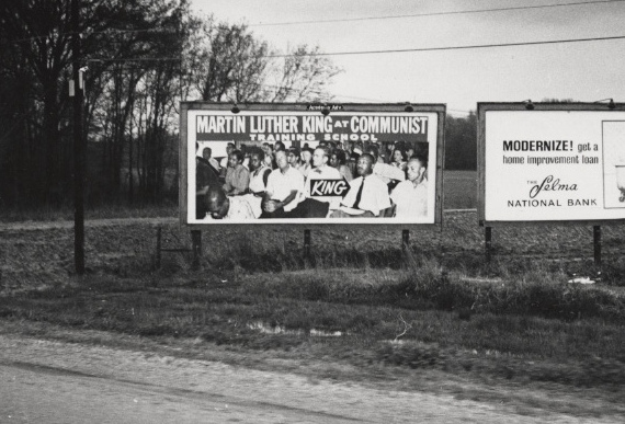 1965 anti-civil rights billboard in Selma, Ala., showing Martin Luther King., Jr., at the Highlander School. (Flickr/Penn State Special Collections)