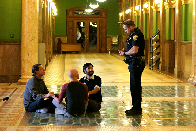 Anti-coal protesters conducted a sit-in last summer at the Montana Capitol building. (Coal Export Action / Rae Breaux)