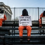 Witness Against Torture activists hold signs as part of January 11 actions in Washington, D.C. (Flickr/Justin Norman)