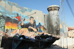 Graffiti covers an Israeli wall and guard tower in Aida Refugee Camp. (Left in Focus/Bryan MacCormack)