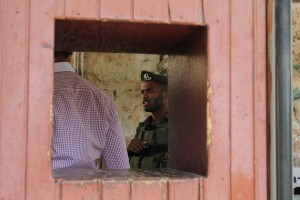 An Israeli soldier at a checkpoint in Hebron. (Left in Focus/Bryan MacCormack)