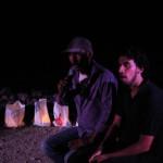 A villager in Khan al-Ahmar tells his story to Freedom Theatre actor Faisal Abu Alhayjaa. (Left in Focus/Bryan MacCormack)