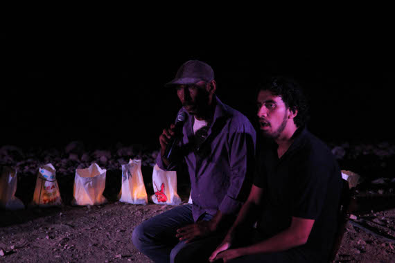 A villager in Khan al-Ahmar tells his story to Freedom Theatre actor Faisal Abu Alhayjaa. (Left in Focus/Bryan MacCormack)