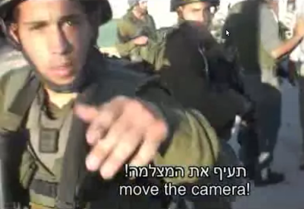 An Israeli soldier gives an order to a videographer. Still from B'Tselem video in Hebron, August 2008. (YouTube/mission4uyt)