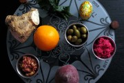 Seder plate with the recent additions of the olives and the orange. (TheKitchn)