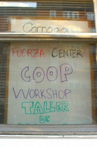 A handmade sign advertises the cooperative workshops in the window of Church of the Prophecy. (Peter Rugh / WNV)