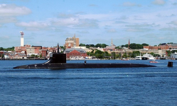 The fast-attack submarine USS Seawolf (SSN 21) sails past downtown New London, Conn., as it makes it way out of the Thames River and into the Long Island Sound. (Flickr/Marion Doss)