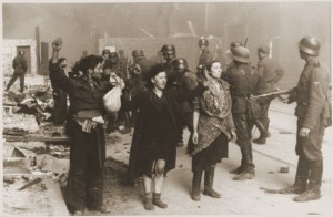 SS troops guard members of the Jewish resistance captured during the suppression of the Warsaw ghetto uprising. (US Holocaust Memorial Museum)