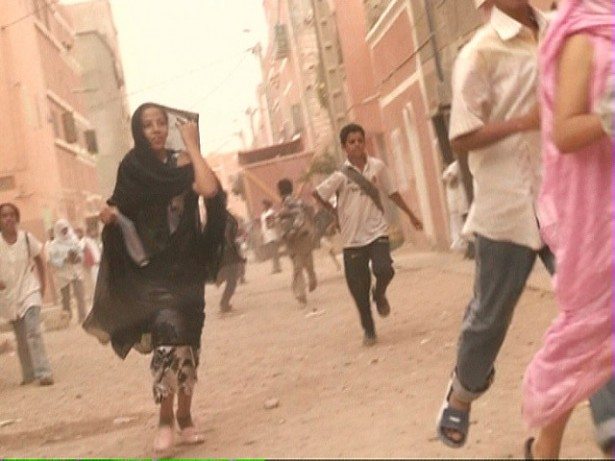 Demonstrators running away from occupation forces in Laayoune, the capital city of Western Sahara.(Flickr/Saharauiak)