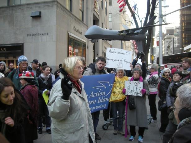 Ann Wright addresses the crowd outside Rockefeller Center. (WNV/Eric Stoner)