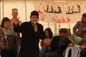 A speaker in Global Square's occupied tent at the 2013 World Social Forum in Tunis. (WNV/Marisa Holmes)