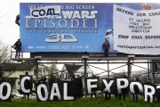 Coal export opponents in Oregon engage in billboard modification to get their message out. (Portland Rising Tide)