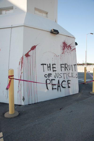 A slogan written by Rice and her accomplices and smeared with human blood on a structure at the Y-12 nuclear facility. (Transform Now Plowshares)